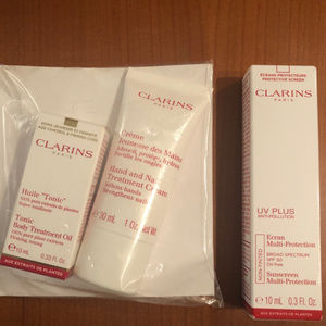 CLARINS 3-piece sunscreen, body oil & hand / nail